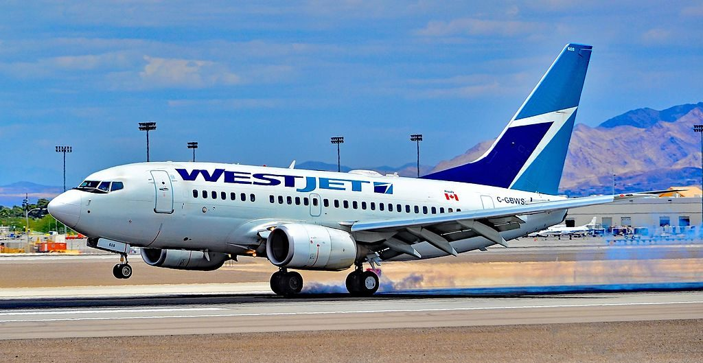 Boeing 737 6CT C GBWS WestJet landing at Las Vegas McCarran International Airport LAS KLAS