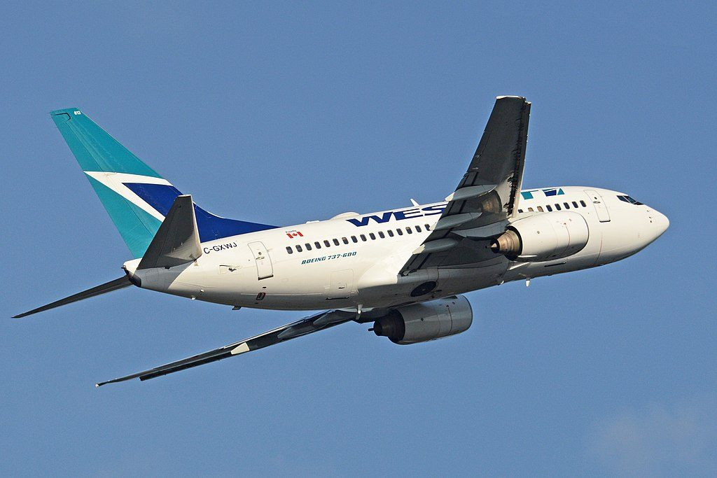 Boeing 737 6CT WestJet aircraft C GXWJ at George Bush Intercontinental Airport departing to Calgary