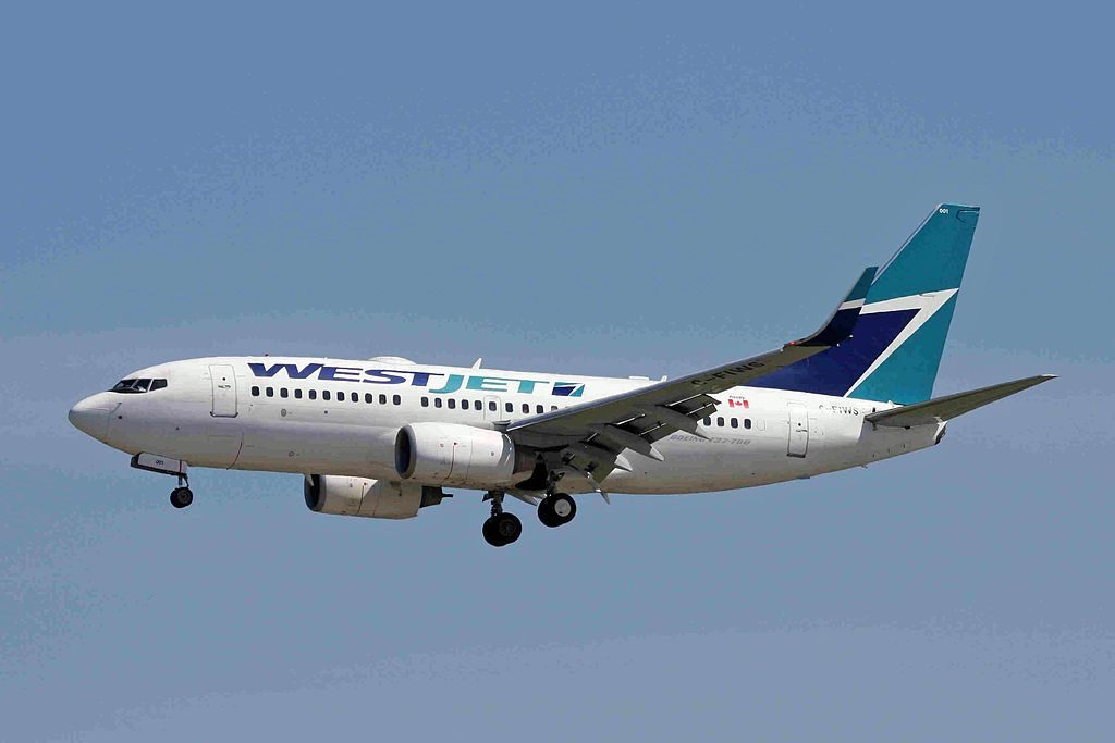 Boeing 737 700 of WestJet C FIWS at Vancouver International Airport