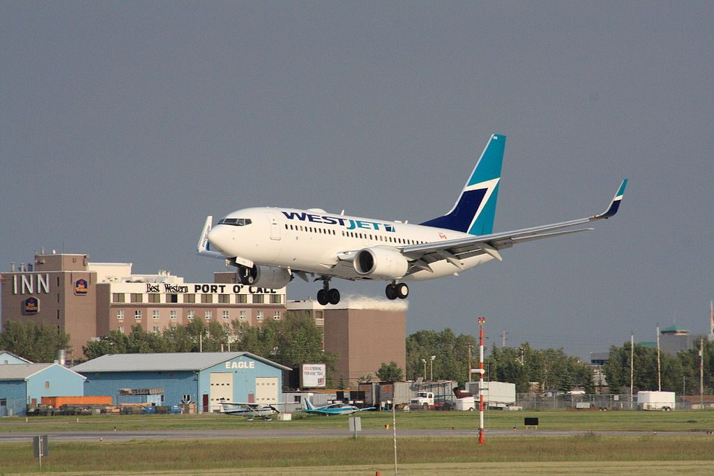 Boeing 737 700 of WestJet C GWBJ landing at Calgary International Airport