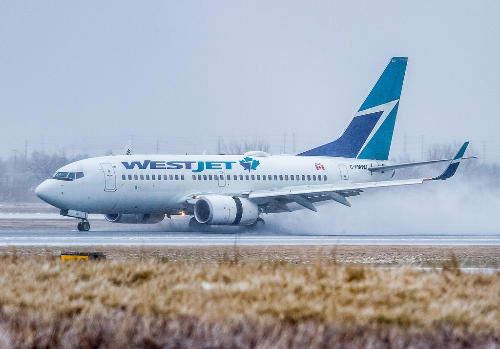 Boeing 737 700wl WestJet C FMWJ landing on heavy rain at Toronto Pearson International Airport