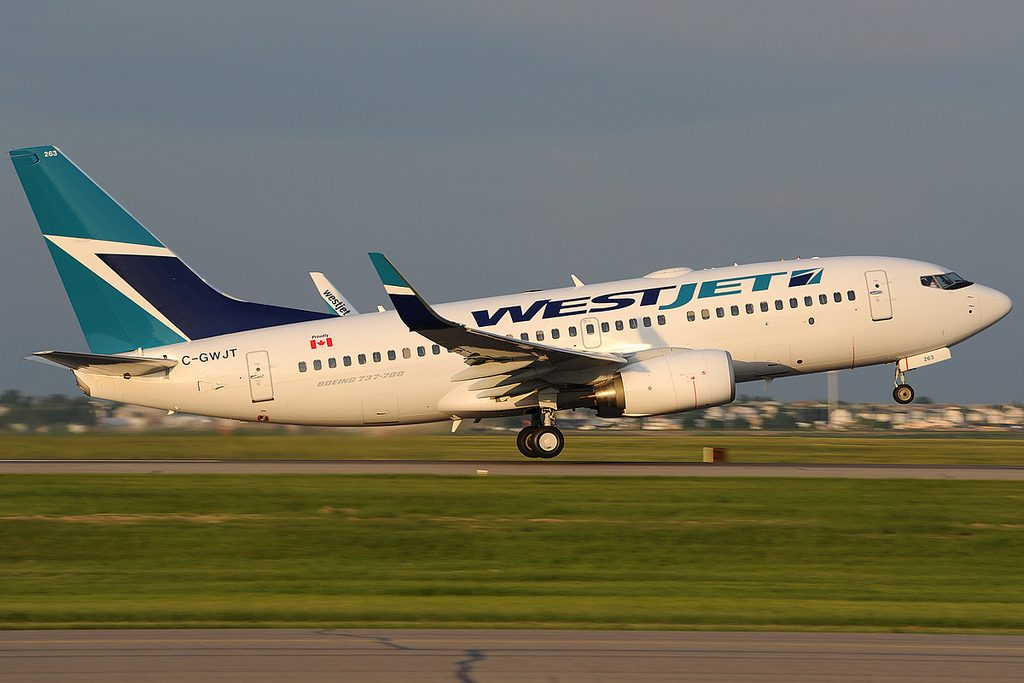 Boeing 737 7CT WestJet Airlines C GWJT takeoff at Calgary International Airport