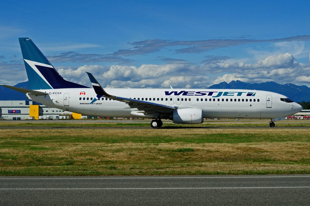 Boeing 737 800 WesJet C FCSX at Vancouver International Airport