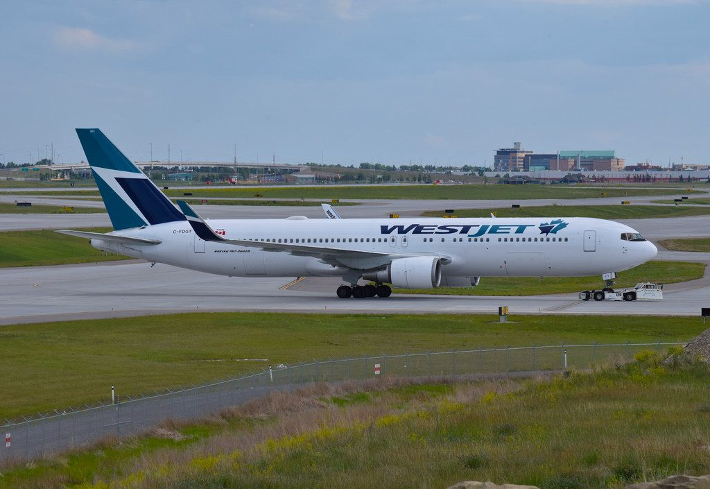 Boeing 767 338ER WL WestJet C FOGT at Calgary Airport After landing from Gatwick heads from concourse B to Apron 1 due to maintenance