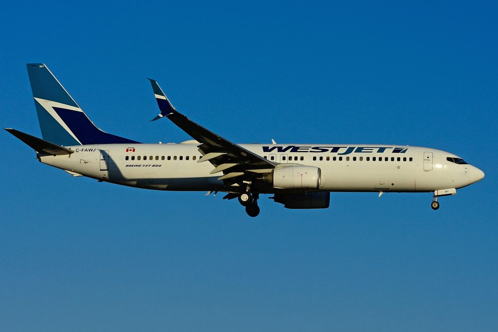 Boeing B737 8CT WestJet C FAWJ landing at Toronto Lester B. Pearson Airport YYZ with Scimitar winglets