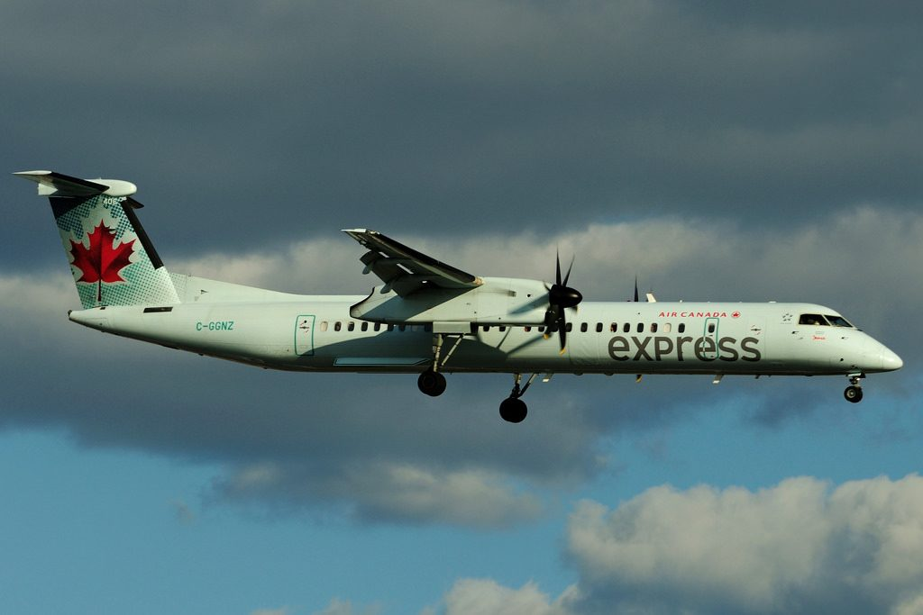 Bombardier DHC 8Q 402 C GGNZ Air Canada Express operated by JAZZ landing at Toronto Lester B. Pearson Airport YYZ