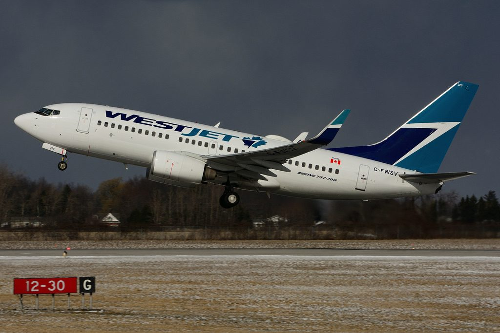 C FWSV Boeing B737 7CTW WestJet departing at Hamilton International Airport YHM