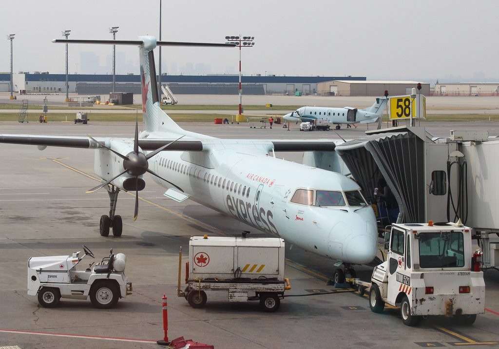 C GBJZ Air Canada Express Jazz Bombardier Q400 sitting at the gate in Calgary Airport