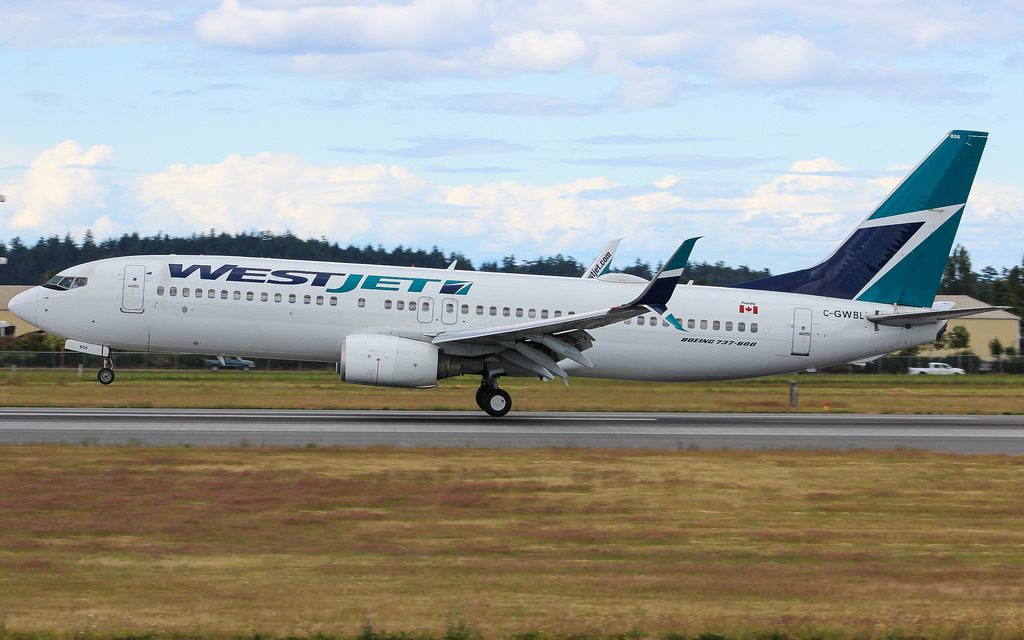 C GWBL WestJet Boeing 737 8CT WL landing at Victoria International Airport YYJ