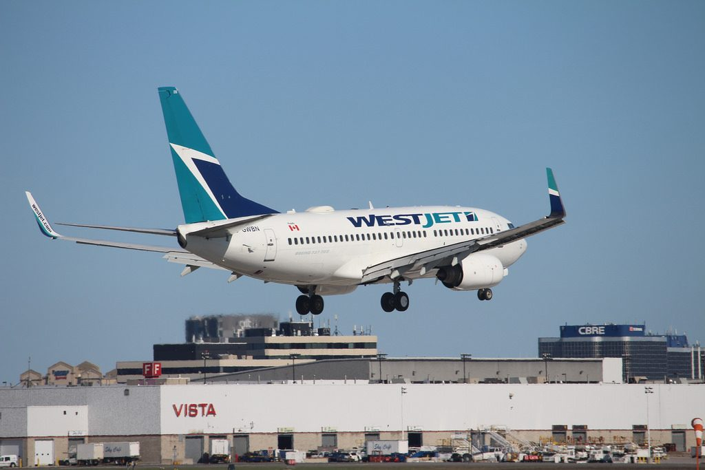 C GWBN Boeing 737 700 Westjet departing Tampa International Airport to YYZ