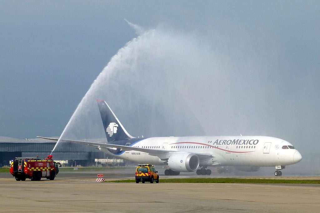 N961AM Boeing 787 8 Dreamliner AeroMexico passing under the water cannon salute for its inaugural B787 service to LHR