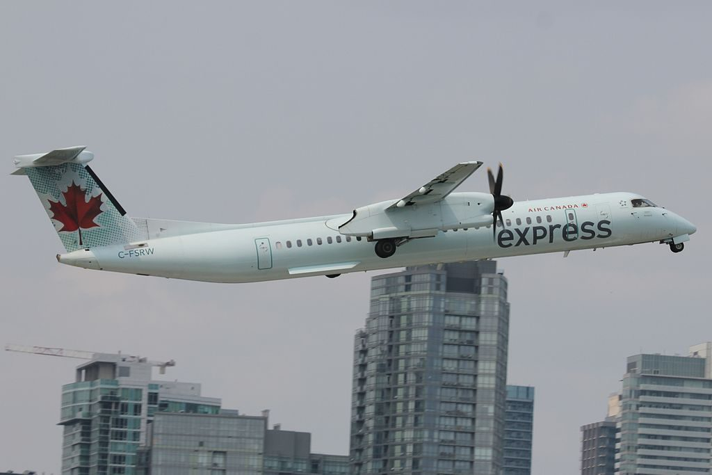 SkyRegional Air Canada Express Bombardier Dash 8 Q400 C FSRW departs at Toronto City Centre Airport
