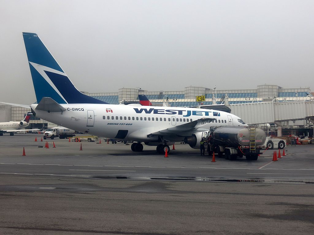 WestJet Airlines Boeing 737 600 C GWCQ at LaGuardia Airport