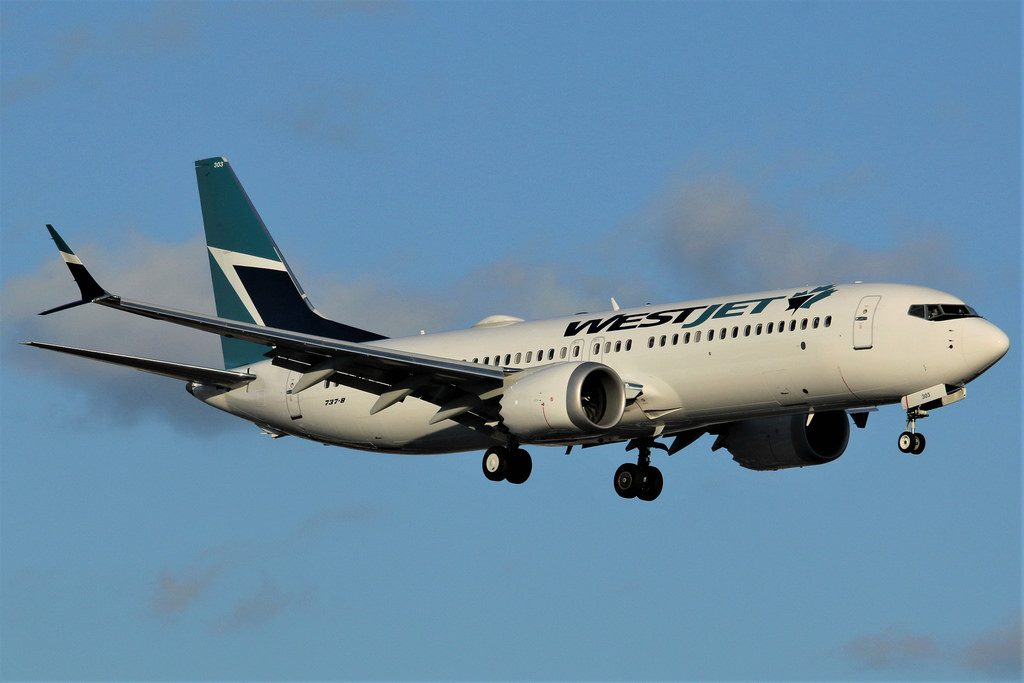 WestJet Airlines Boeing 737 Max 8 C GXAX on final approach at Calgary Airport YYC from Toronto Pearson International YYZ
