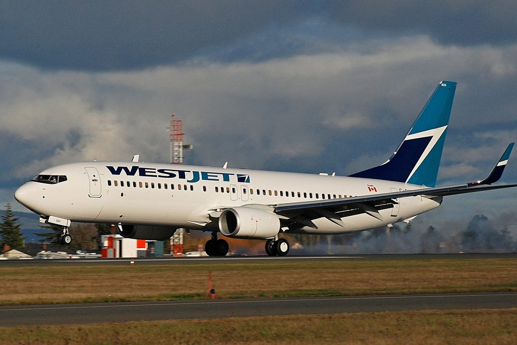 WestJet Airlines Fleet Boeing 737 800 C GVWA landing at Victoria International Airport