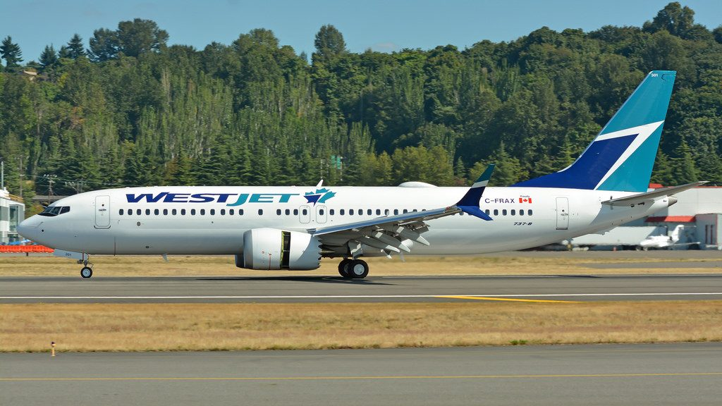 WestJet B737 Max 8 C FRAX landing at Boeing Field Airport with reverse thrust engines