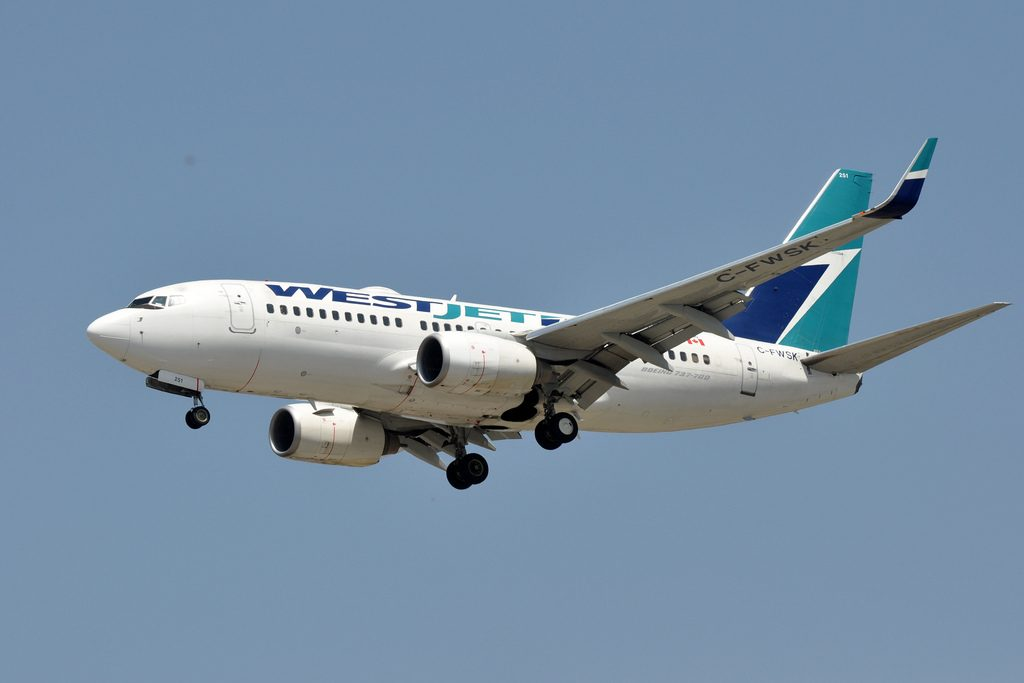 WestJet Boeing 737 700 C FWSK on final approach at LAX Airport