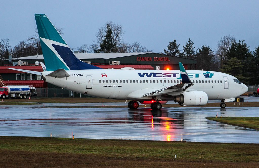 WestJet Boeing 737 700 C FXWJ Victoria International Airport YYJ departing to Cancun