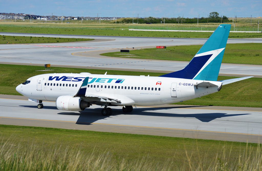 WestJet Boeing 737 700 C GSWJ on its way to 17L at Calgary International Airport