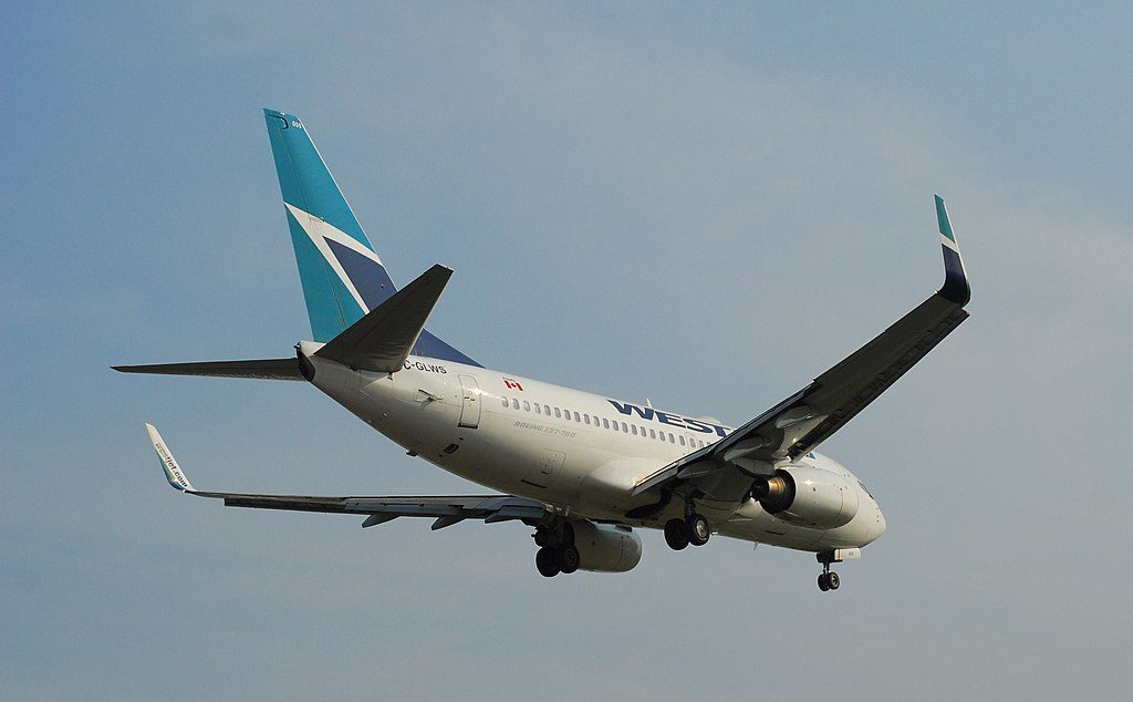 WestJet Boeing 737 76N C GLWS on final approach at Armstrong Airport IATA YYW ICAO CYYW