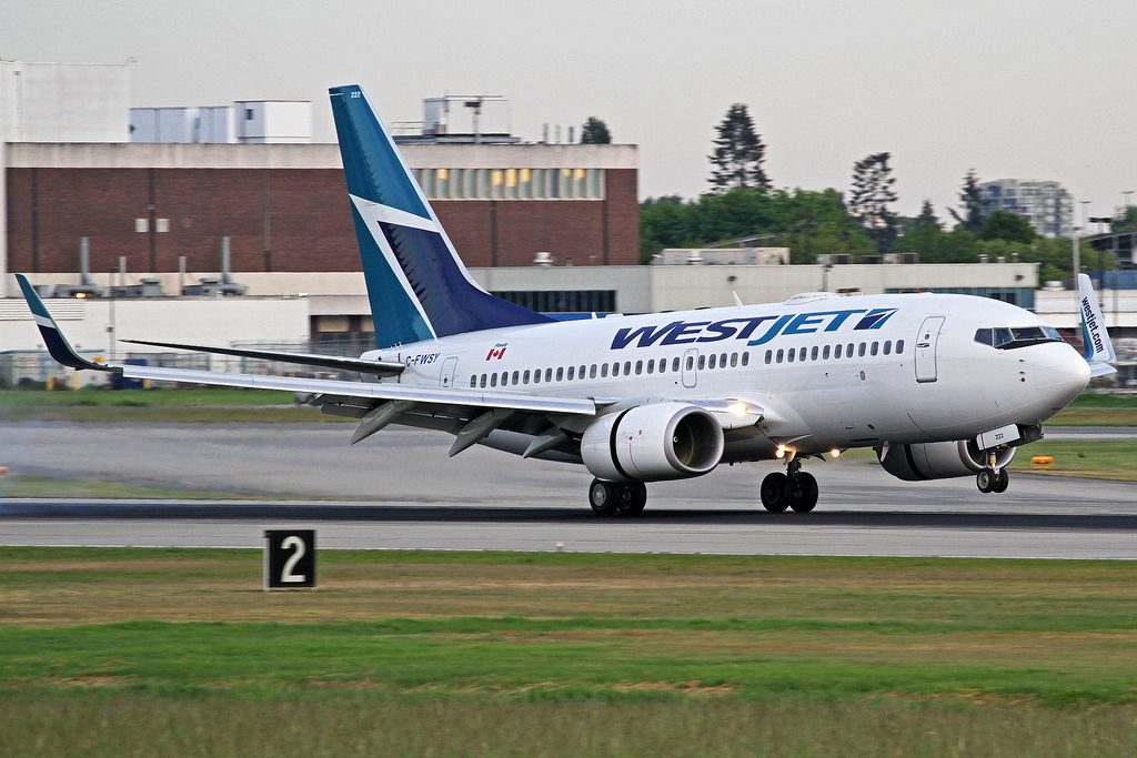WestJet Boeing 737 7CT C FWSY landing at Vancouver International Airport YVR