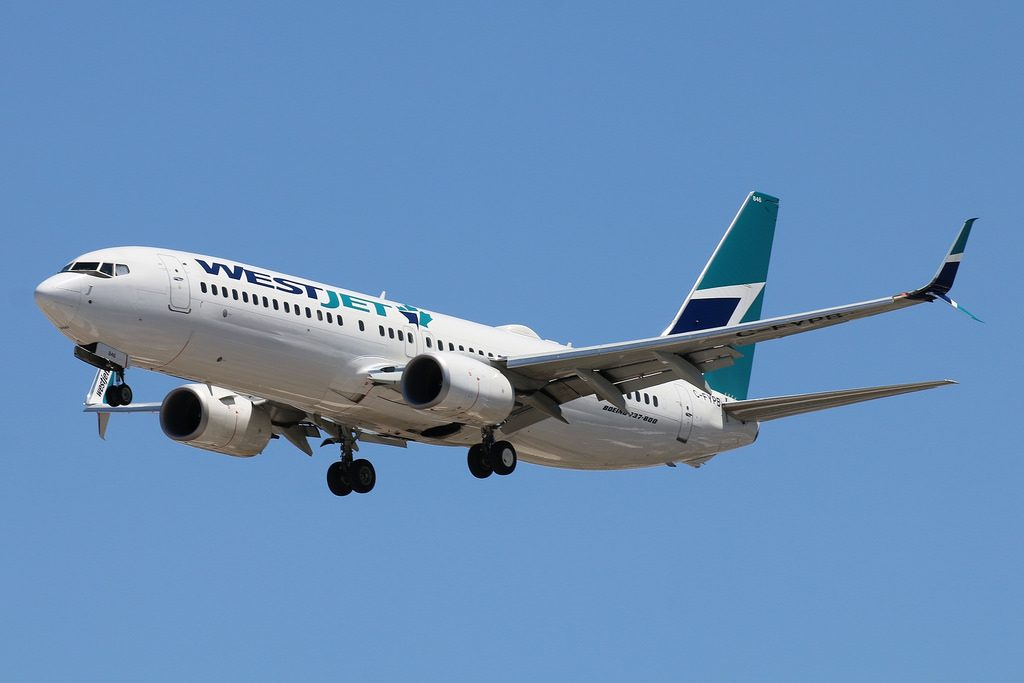 WestJet Boeing 737 800 C FYPB on final approach at LAS Airport