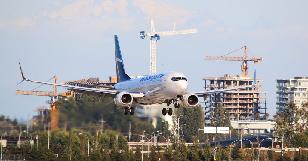 WestJet Boeing 737 8CT C FUCS landing at Vancouver International Airport