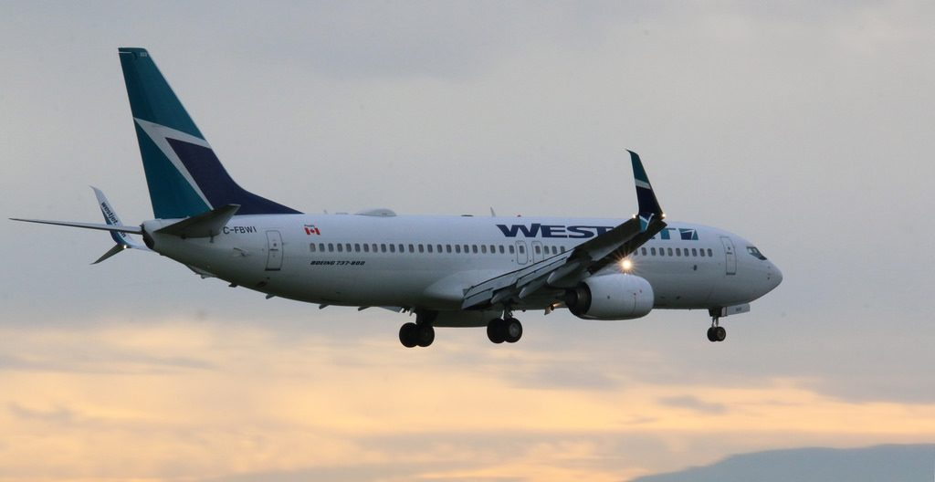 WestJet Boeing 737 8CTWL C FBWI on final approach at Vancouver International Airport