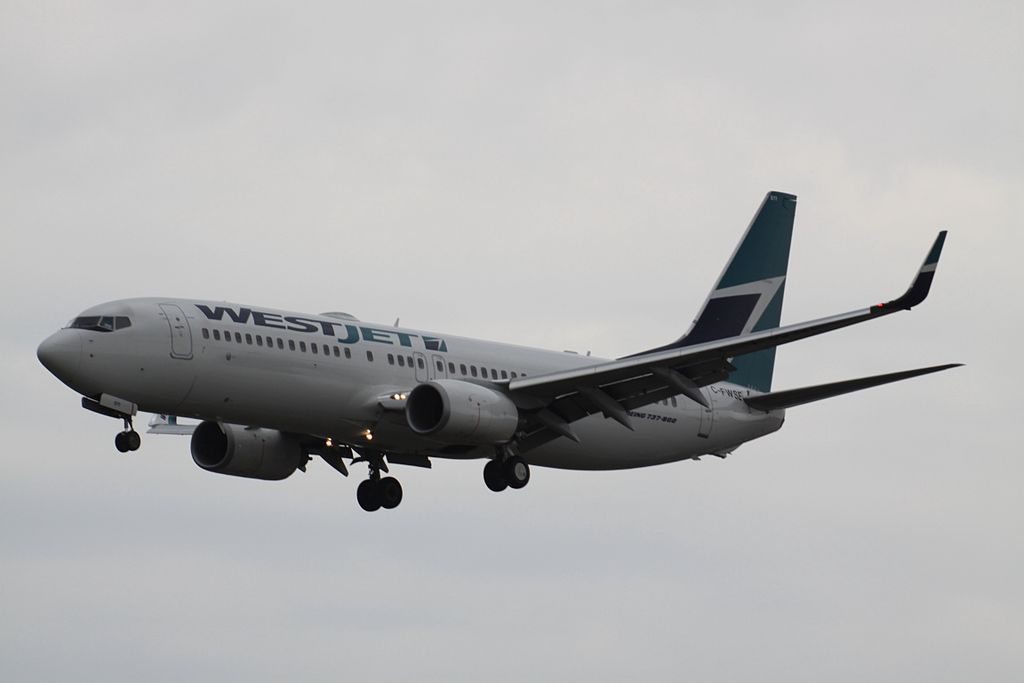 WestJet C FWSE Boeing 737 800 on final approach at Toronto Pearson International Airport