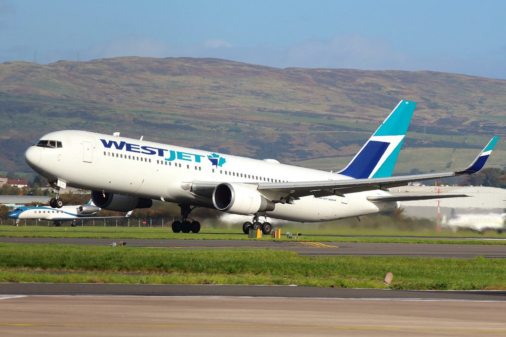 WestJet C GOGN Widebody Boeing 767 300ERW leased from BCC departing Glasgow International Airport Scotland