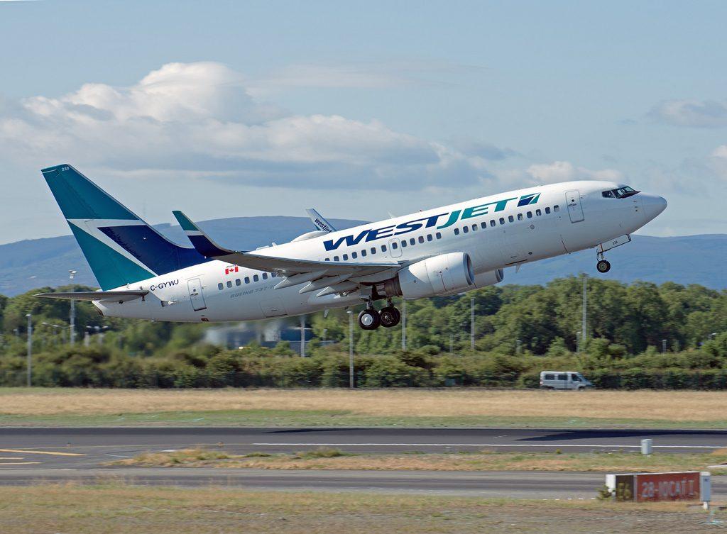 WestJet C GYWJ Boeing 737 7CTWL departing Dublin Airport Ireland