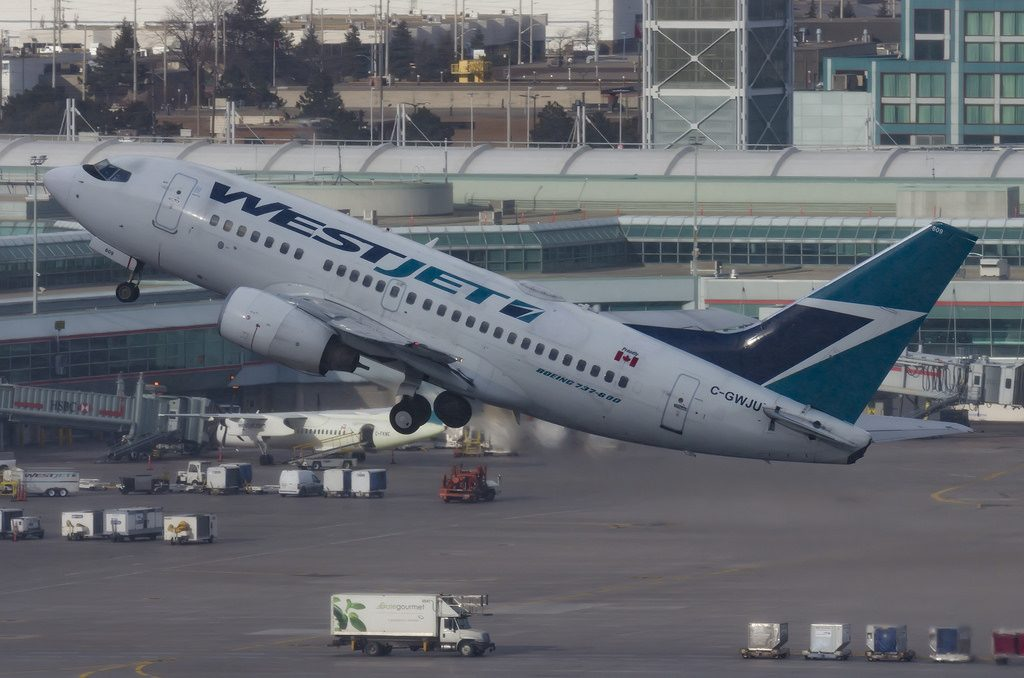 WestJet fleet Boeing 737 6CT C GWJU departing Toronto Pearson Airport