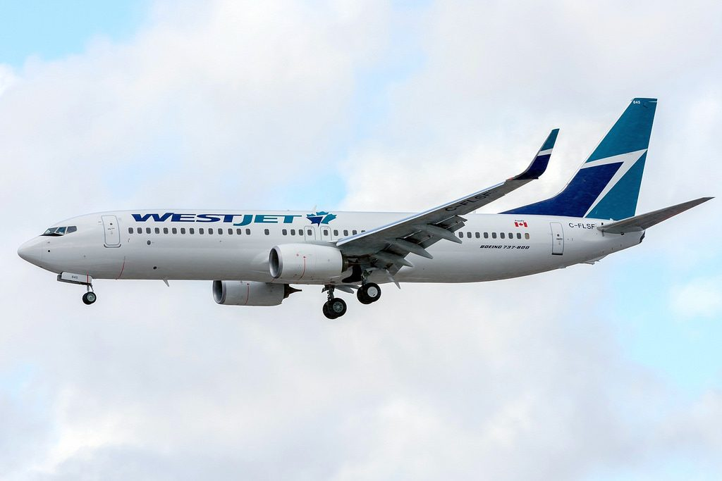 WestJet new 738 delivery 13. Nov 2015 C FLSF with new Maple Leaf logo landing Toronto in light snow