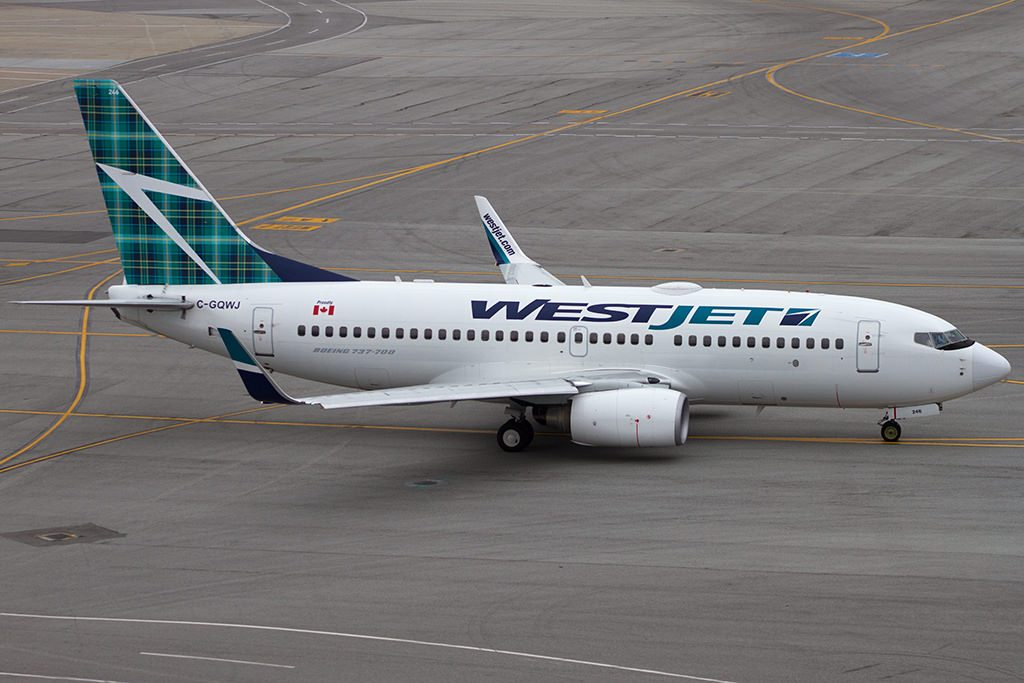 Westjet 737 700 C GQWJ Tartan taxiing out at SFO