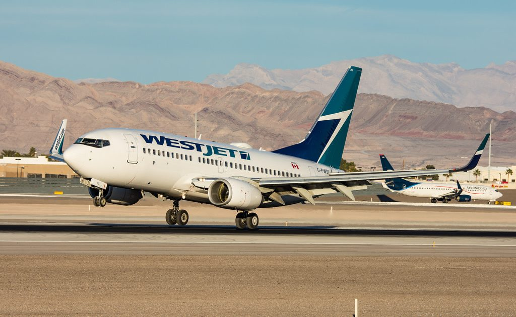 Westjet Boeing 737 7CT C FWSF landing at McCarran International Airport KLAS
