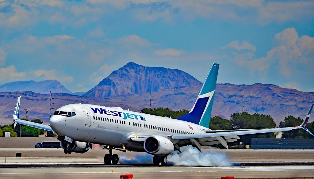 Westjet Boeing 737 8CT C GWSR landing at Las Vegas McCarran International