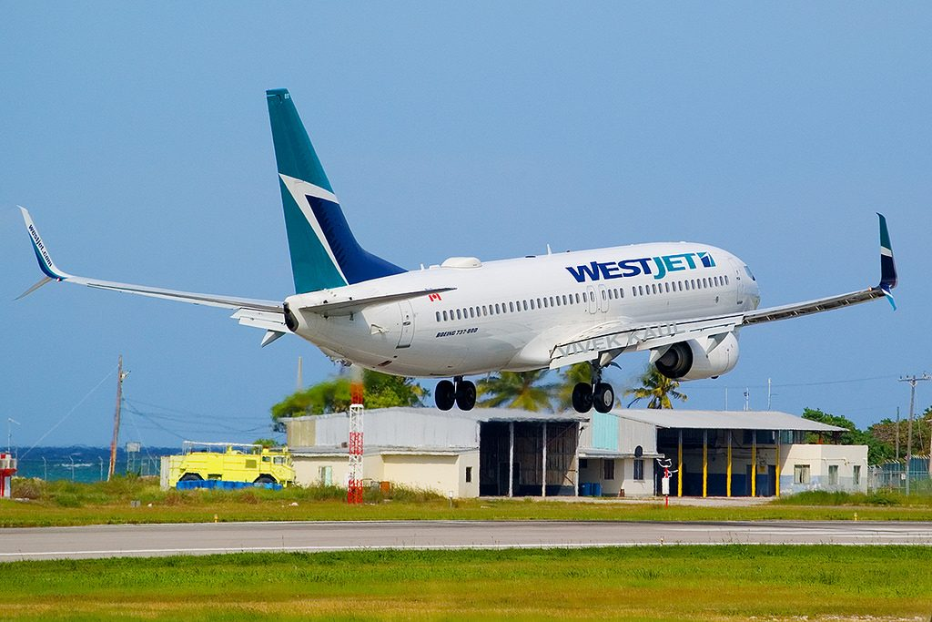 Westjet Boeing 737 8CTWL C FWVJ landing at Montego Bay Jamaica Sangster International Airport MBJ