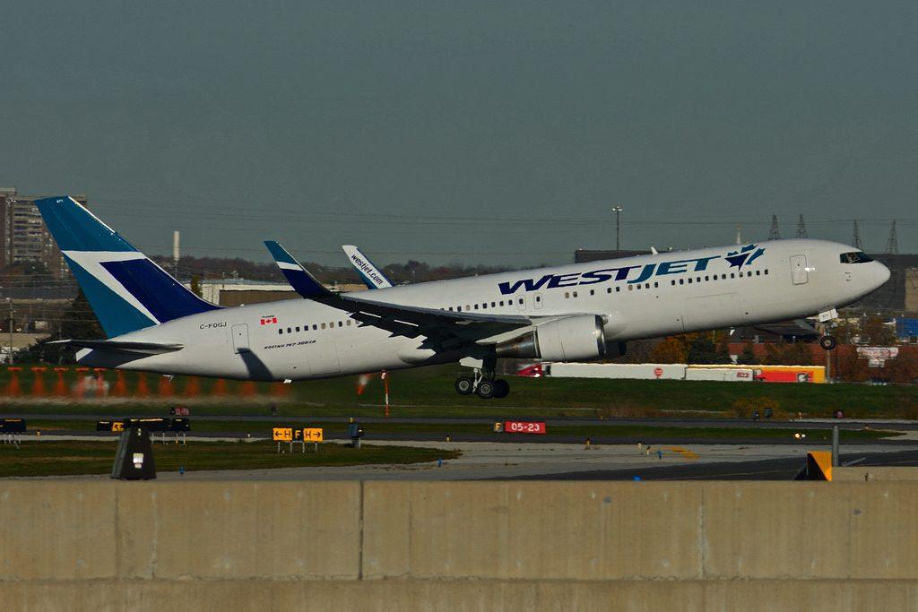 Westjet C FOGJ Boeing 767 300ERW departing Toronto Lester B. Pearson Airport YYZ