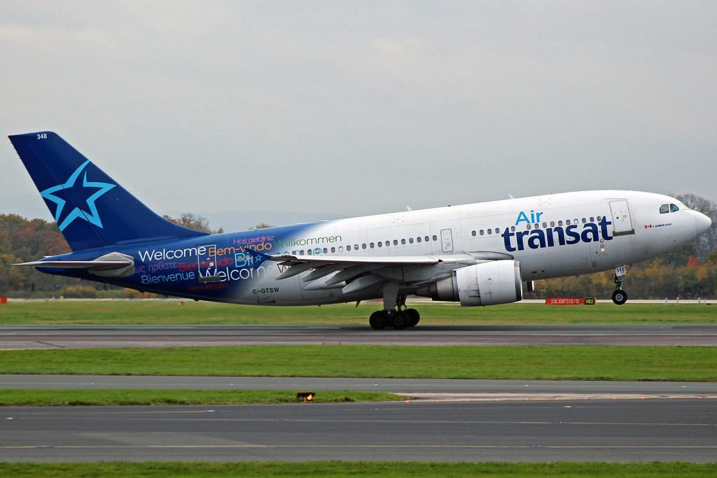 Air Transat Airbus A310 304 C GTSW departs from Manchester Airports runway 23R with flight TS293 to Toronto