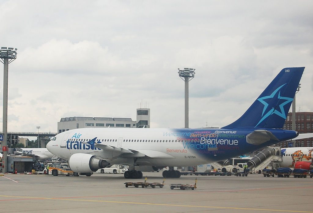 Airbus A310 300 of Air Transat C GTSH Pushback tractors in Frankfurt Airport