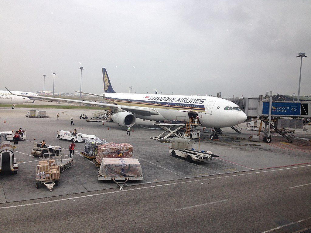 Airbus A330 300 9V SSF Singapore Airlines on boarding gate at Kuala Lumpur International Airport