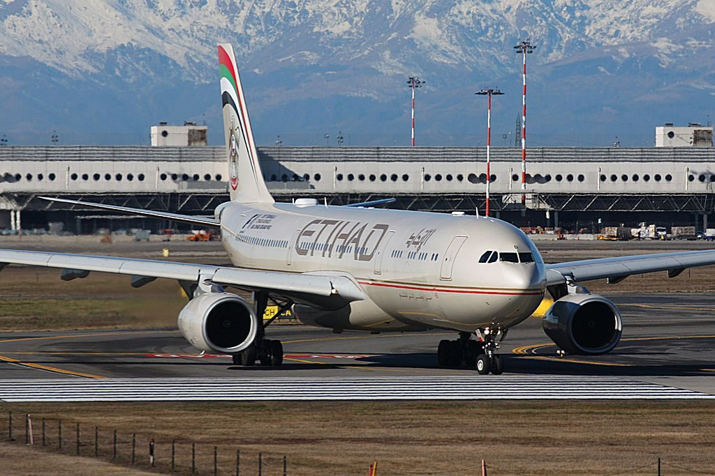 Airbus A330 300 Etihad Airways A6 AFD Taking off from Milan Malpensa