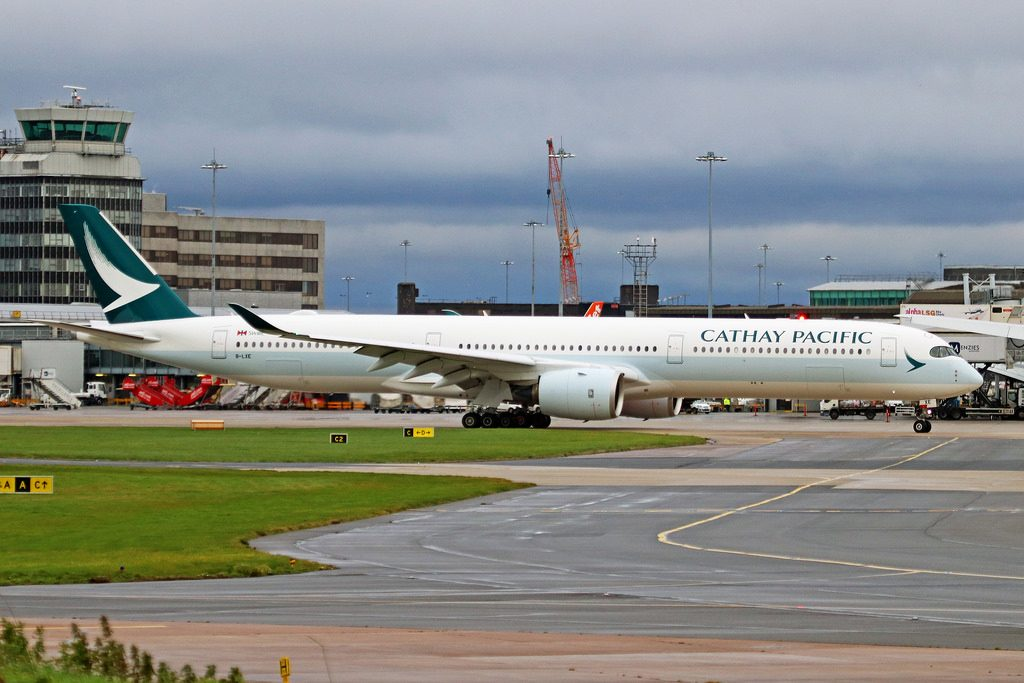 Airbus A350 1000 Cathay Pacific Aircraft Fleet B LXE lining up on runway at Manchester Airport