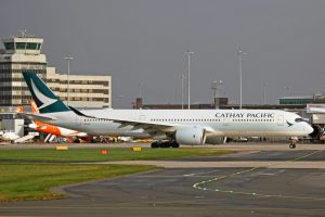 Airbus A350 941 B LRT Cathay Pacific Airways lining up on runway at Manchester Airport