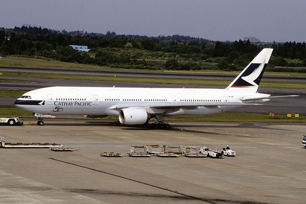 Boeing 777 200 of Cathay Pacific B HNC pushed back at Narita International Airport