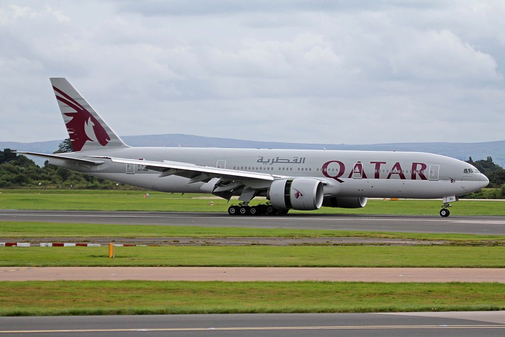 Boeing 777 200LR of Qatar Airways A7 BBI landing at Manchester Airport with reverse thrust engines