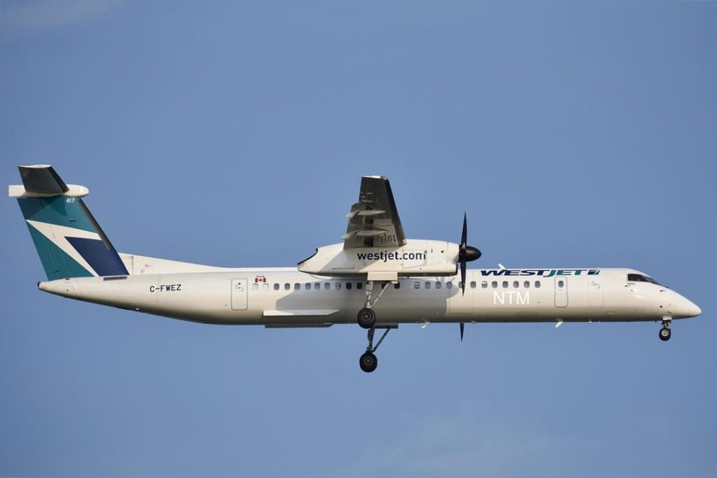 C FWEZ WestJet Encore Bombardier DHC 8 402 Q400 landing on runway 22L at KBOS