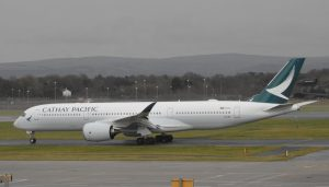 Cathay Pacific Airbus A350 941 B LRX taxiing on runway at Manchester Airport