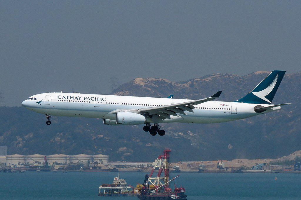 Cathay Pacific B LAO Airbus A330 300 on final approach at Hong Kong International Airport