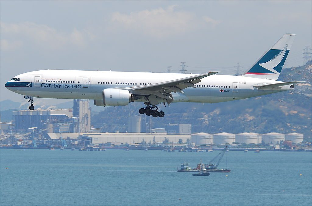 Cathay Pacific Boeing 777 200 B HNA on final approach at Hong Kong International Airport